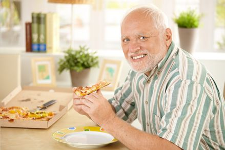 old man eating pizza